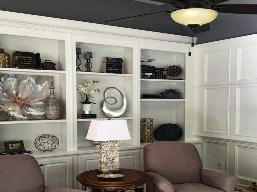 Beautiful Family Room with Custom White Bookcases, Wainscoting & Stone Fireplace